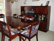 Dining table and 8 chairs with cabinet